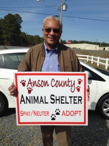 A very proud Mr Lawrence Gatewood, Anson County Manager, hold the sign for the new shelter!